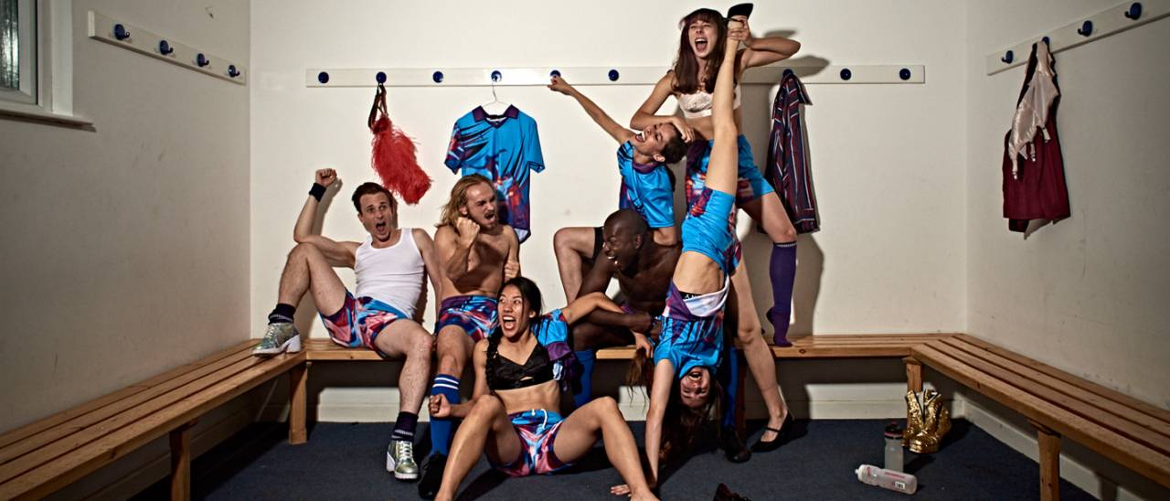 7 dancers screaming with joy, one standing upside down