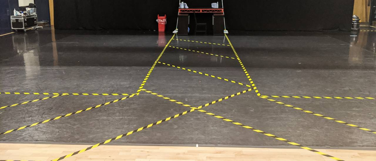 The large 'blue room' dance studio is taped into two separate dancing space using hazard tape