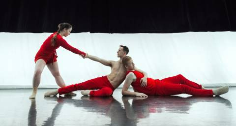 Test Capture image 3 dancers dressed in red 2 on the floor