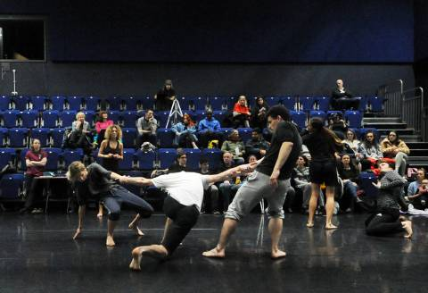 Dances rehearsing in a studio with audience watching